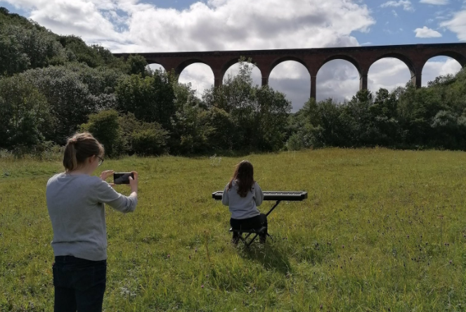 Young women filming in the North East