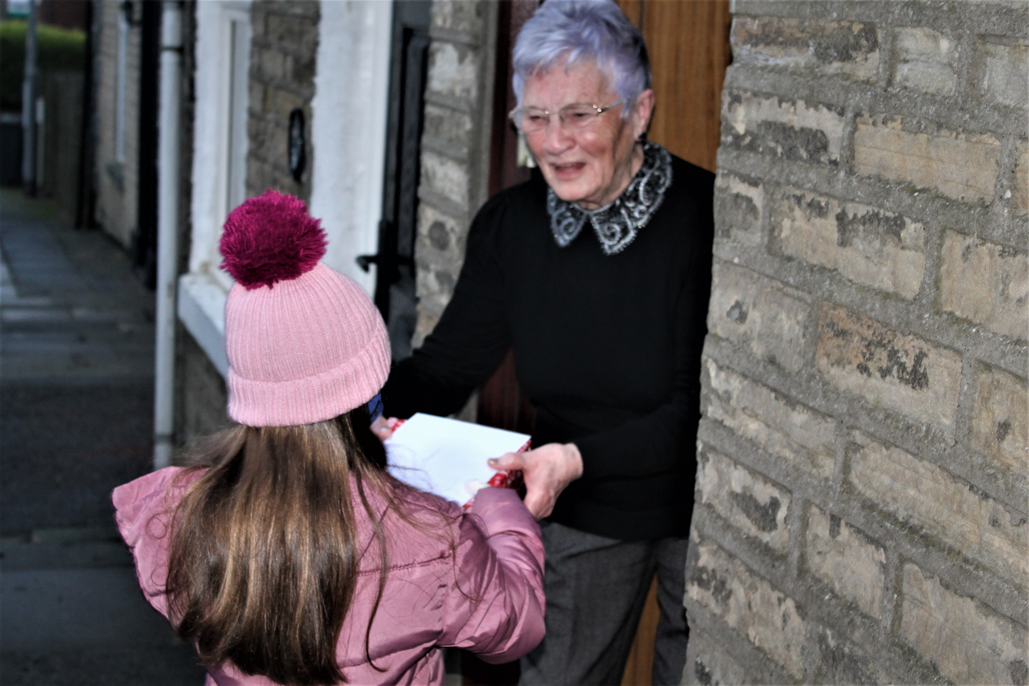 Faith in our Community deliver cards and gift boxes