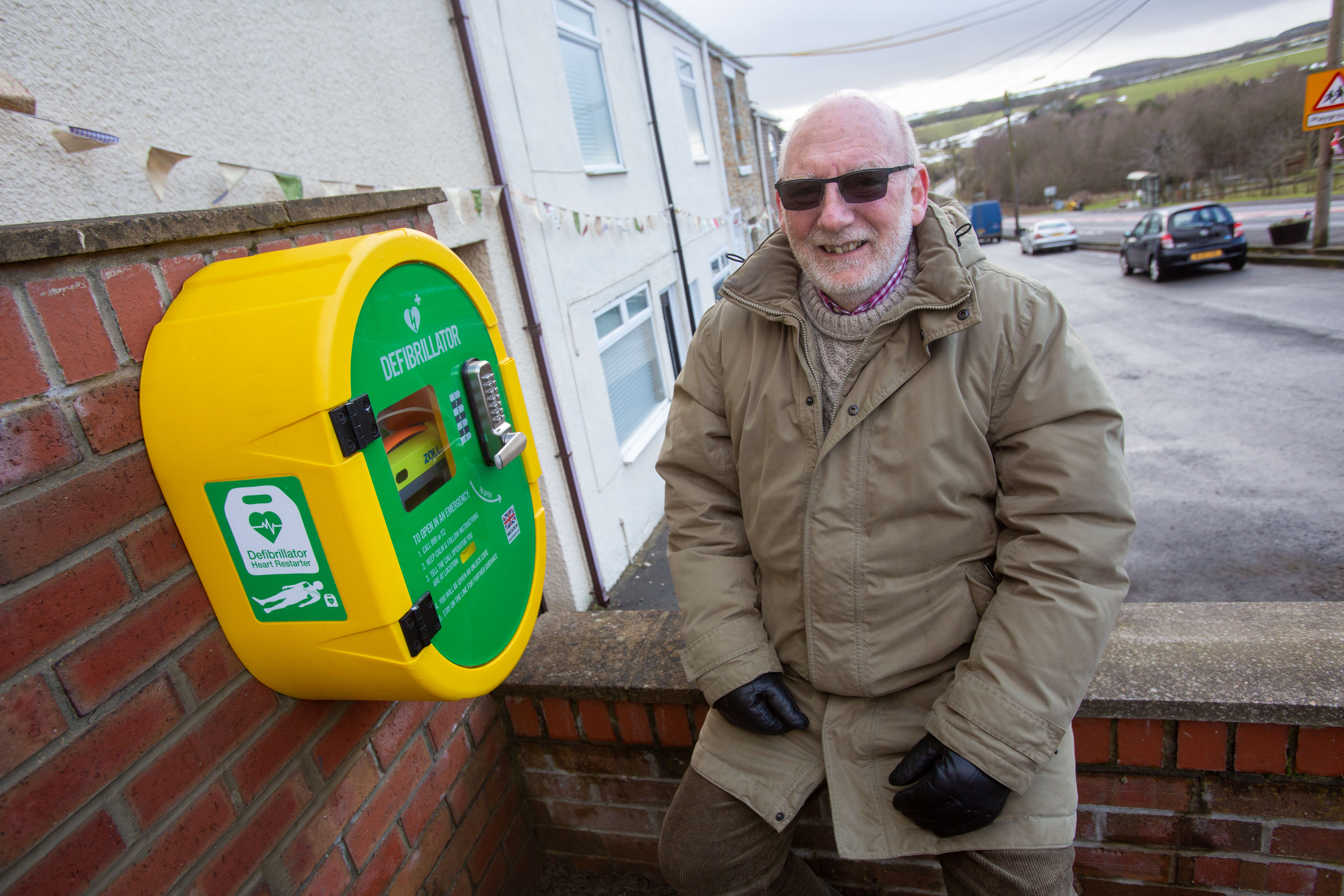 Peter Woff, secretary for TRACC, by the new defibrillator