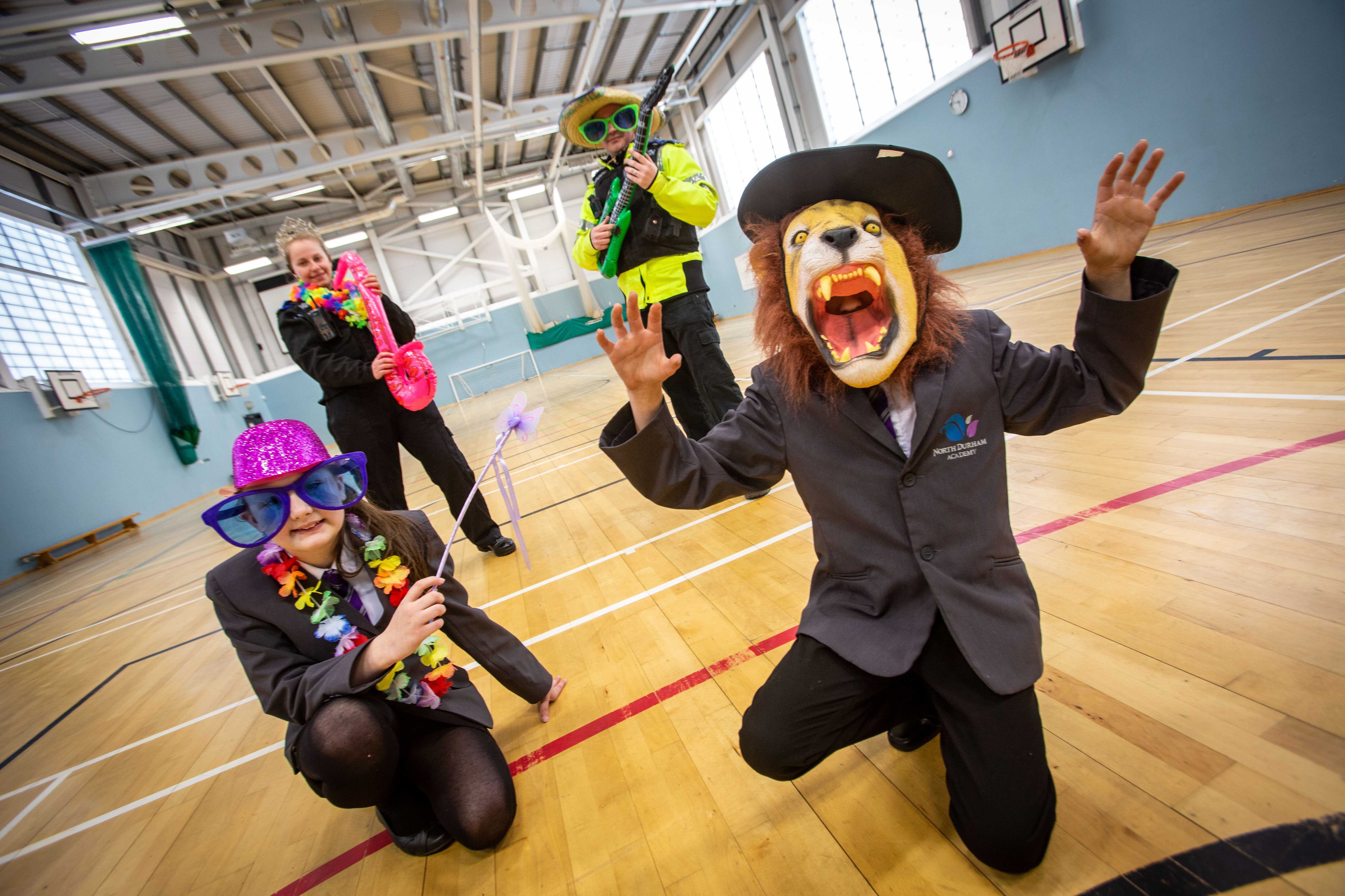 Students from North Durham Academy and local police officers are dressed in bright hats, a lion mask and fun glasses to stand out for stanley